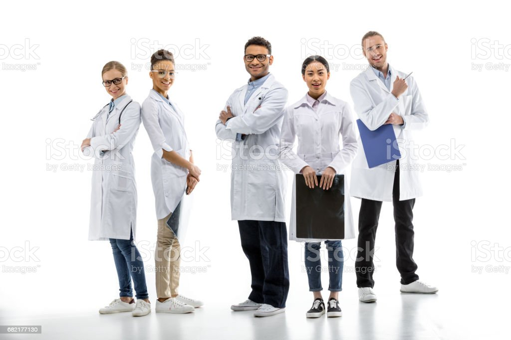 Team of young professional doctors standing together isolated on white stock photo