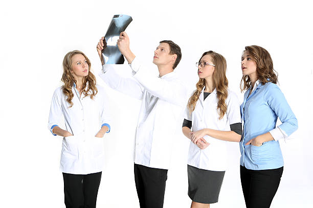 Team of young surgeons stock photo