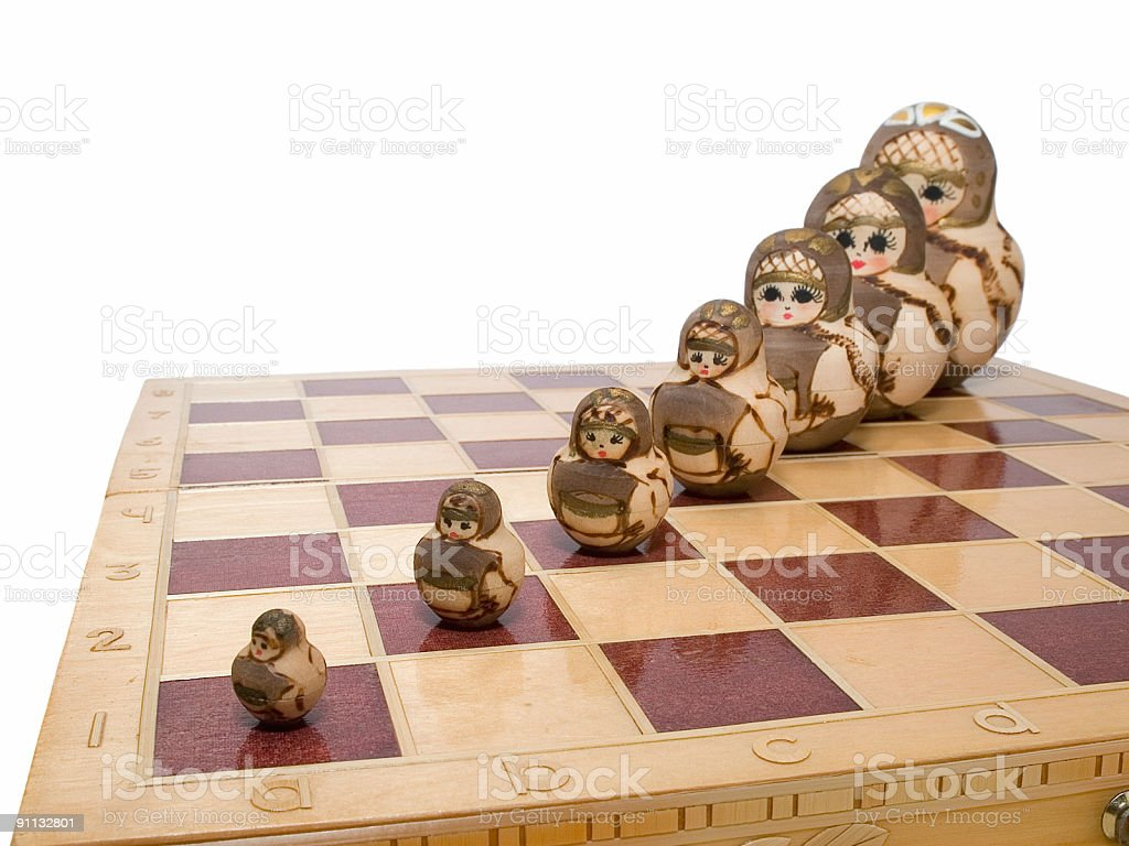 team ordered row nested dolls on chessboard russian art royalty-free stock photo