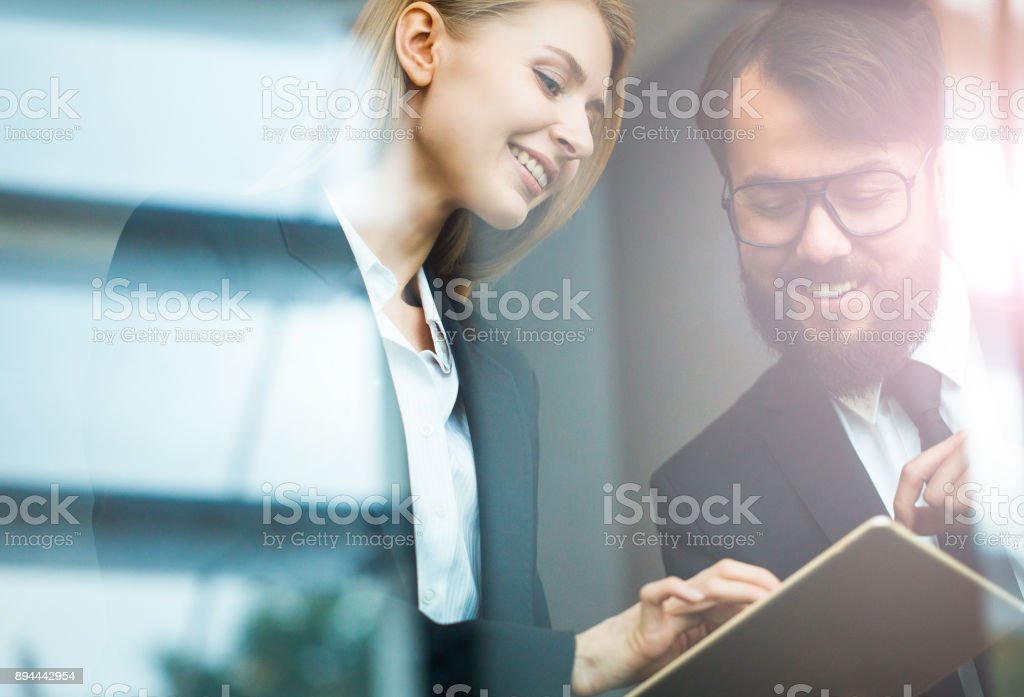 Team partners working in glass office stock photo