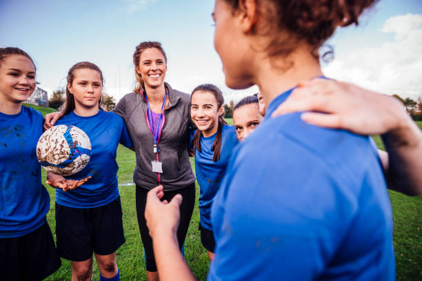 team pep talk - coach stock photos and pictures