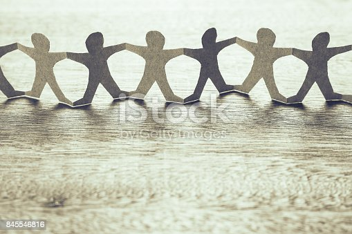 Human chain paper on wood table