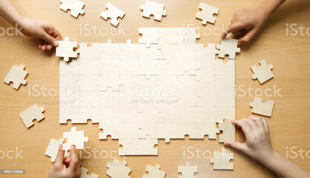 team place parts of puzzle stock photo