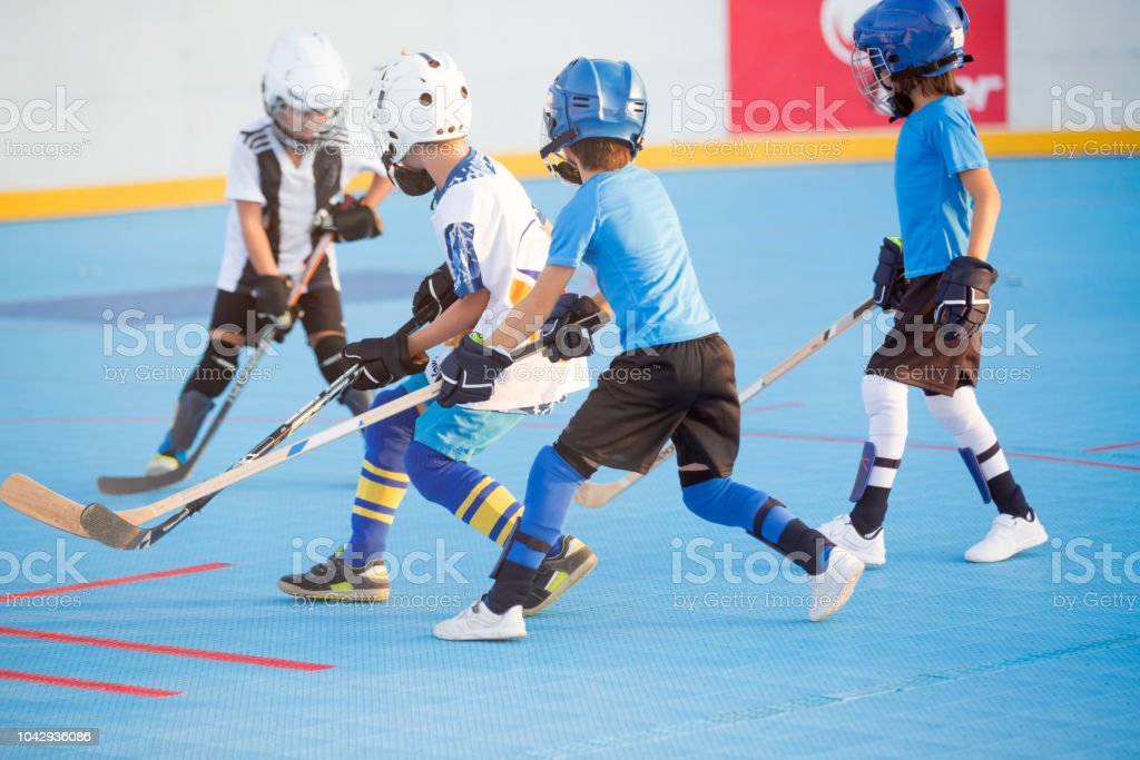 Team players having competitive hockey game stock photo