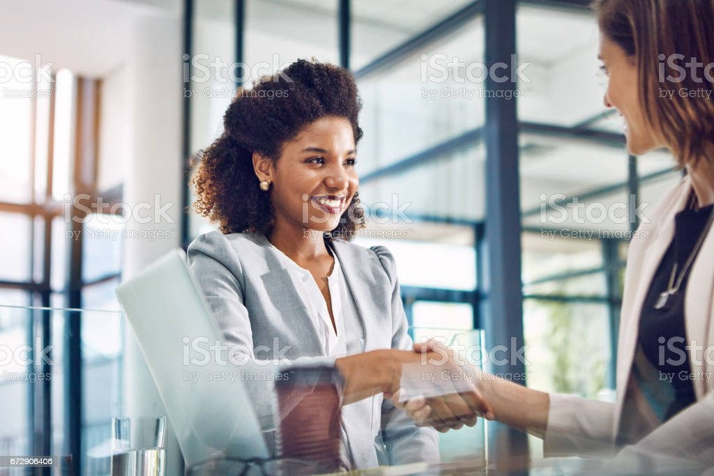 Team players who work together win together stock photo