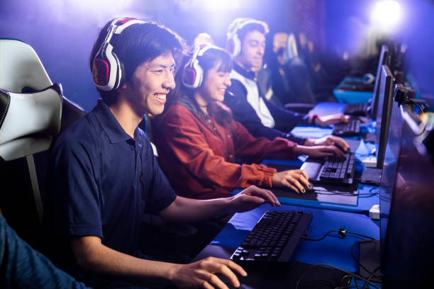 Team Playing Esports Game on Computer stock photo