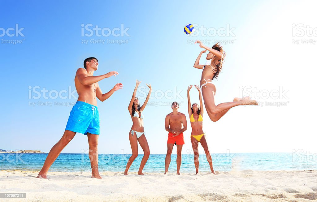 Team plays beach volleyball. royalty-free stock photo