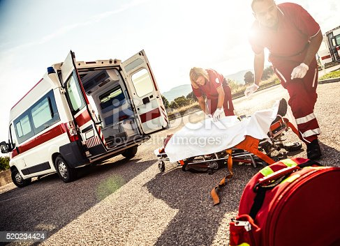 istock EMT team provide first aid on the street 520234424