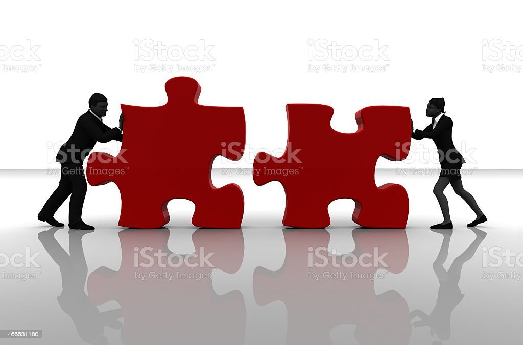 Team pushing jigsaw puzzle pieces royalty-free stock photo