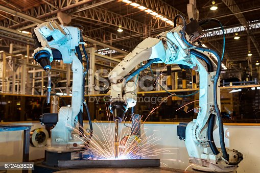 846859964 istock photo Team robot are welding assembly automotive part in factory 672453820