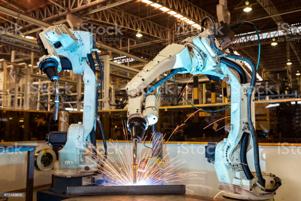 Team robot are welding assembly automotive part in factory stock photo