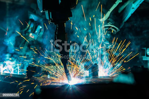 693576566 istock photo Team robot are welding automotive part in factory 999986234