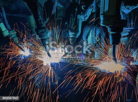 156642859 istock photo Team robot welding in automotive industry 600067842