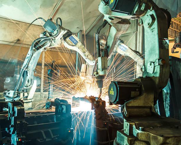 Team robot welding steel motion blur industry. - foto de stock