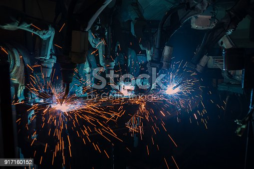 693576566 istock photo Team robots are welding assembly car part in car factory 917160152
