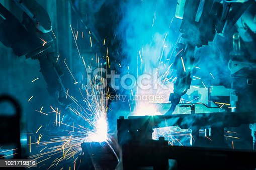 693576566 istock photo Team robots are welding in factory 1021719316