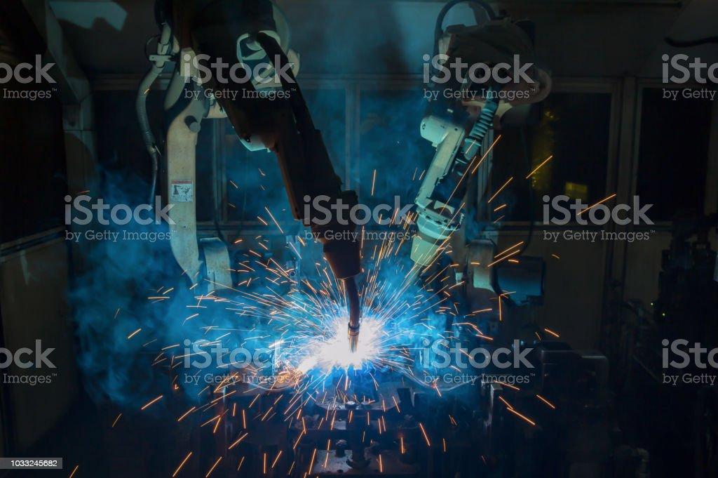 Team robots welding are welding repair automotive part iv factory