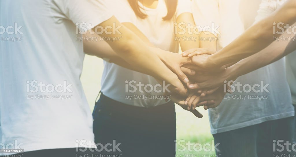 Team teamwork business join hand together concept, Power of male and female volunteer charity work, Stack of people hand stock photo