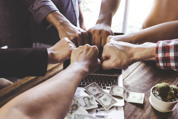 team teamwork business join hand together concept power of volunteer charity work - organizzazione no profit foto e immagini stock