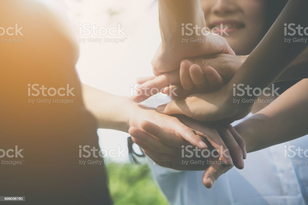 Team teamwork business join hand together concept, Power of volunteer charity work, Stack of people hand stock photo