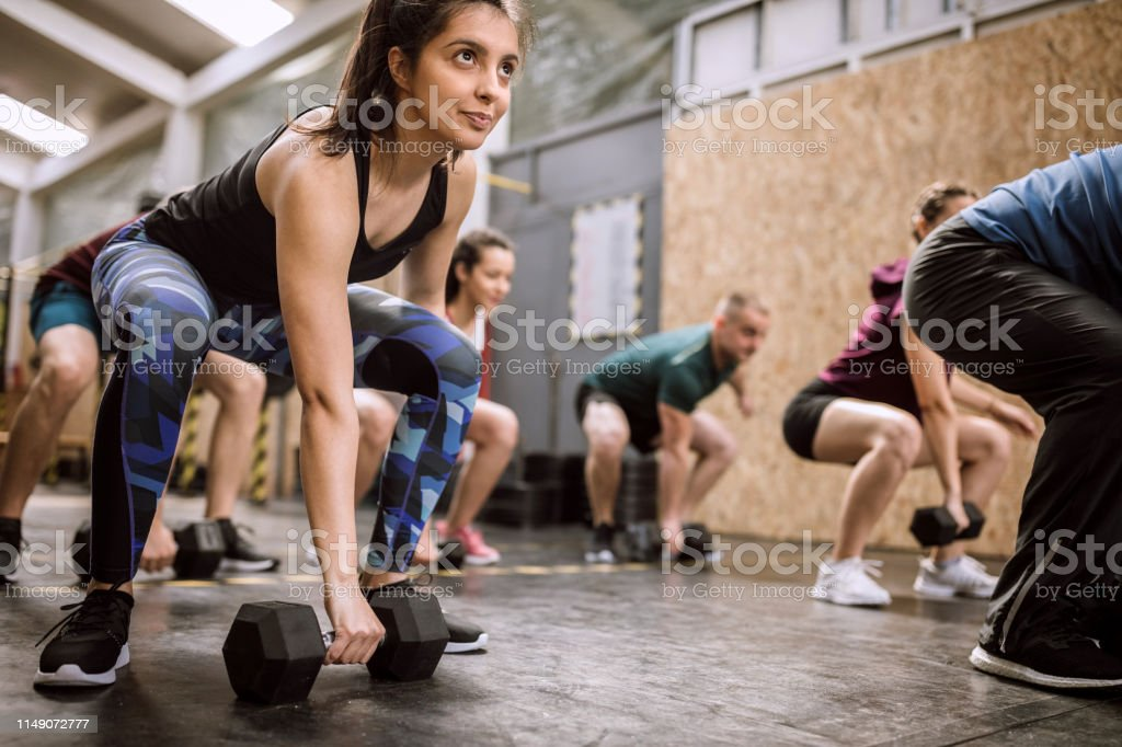 Athlete Team Weightlifting Warm Up Exercises On Cross Training