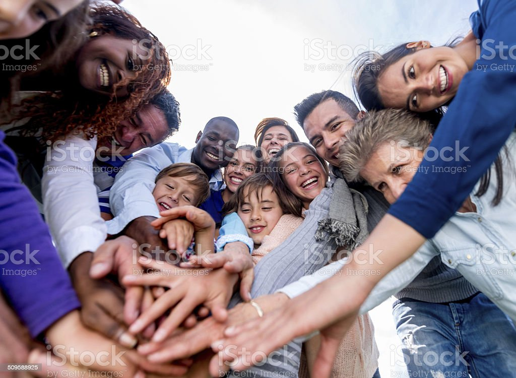 Team with hands together stock photo