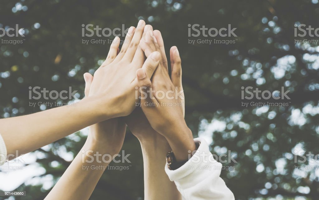 Team work and together concept, Hand of people high five for tag team stock photo