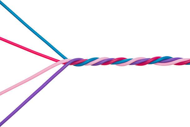 team work concept twisted four wires. - blue yellow band bildbanksfoton och bilder