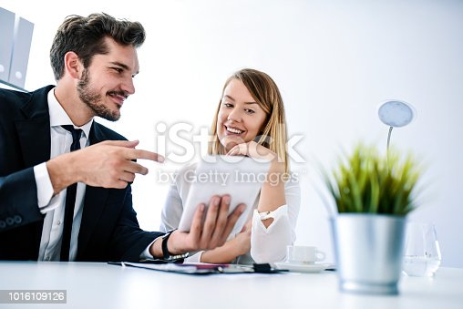 557608497istockphoto Team working at modern office 1016109126