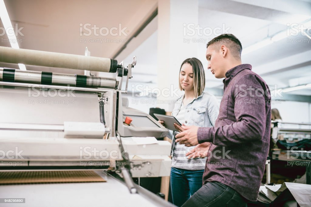 Team Working in Textile Factory on 3D Clothing Printing stock photo