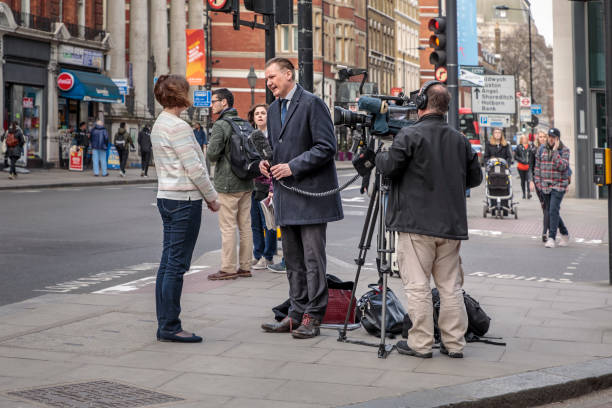 TV team working on a street in London stock photo