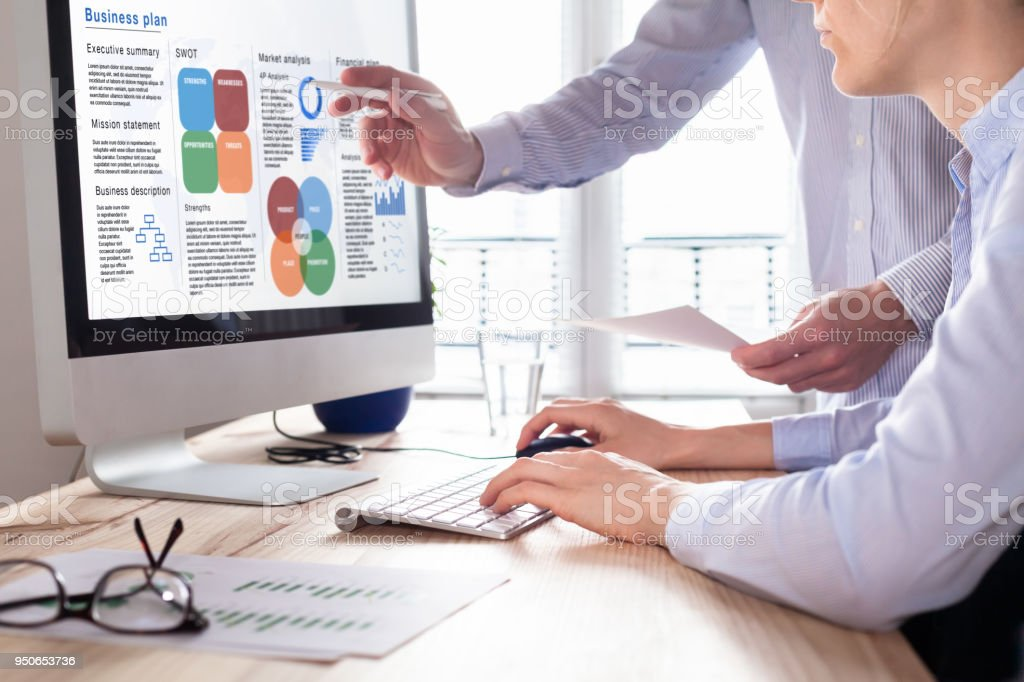 Team working on Business Plan in consulting office, financial analysis stock photo