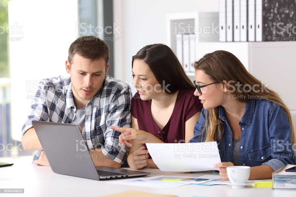 Team working together on line at office stock photo