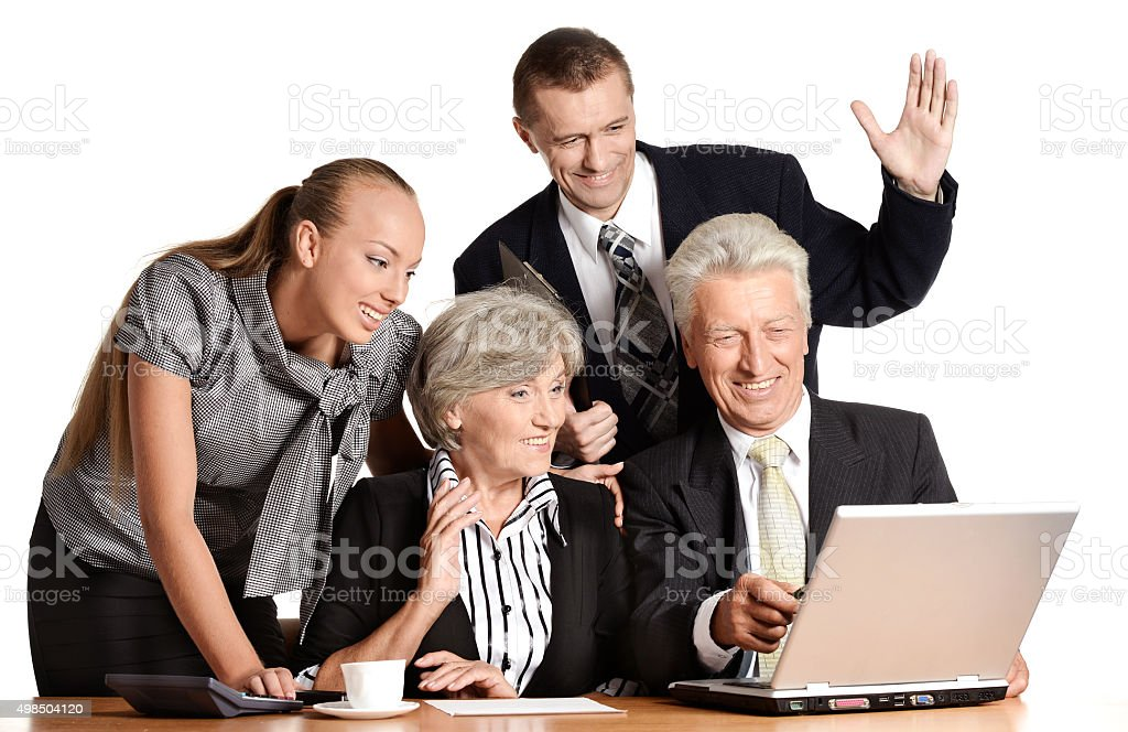 team works with the computer stock photo
