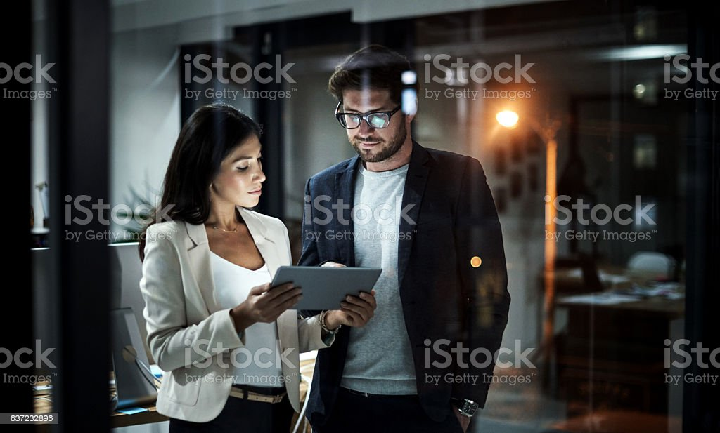 Teaming up to get things done stock photo