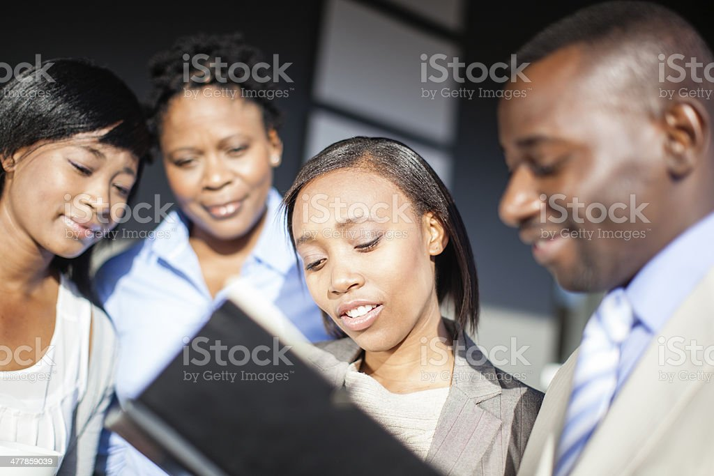 Teammates discussing work load for the day. royalty-free stock photo