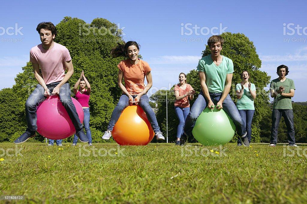 Teams racing on exercises balls stock photo