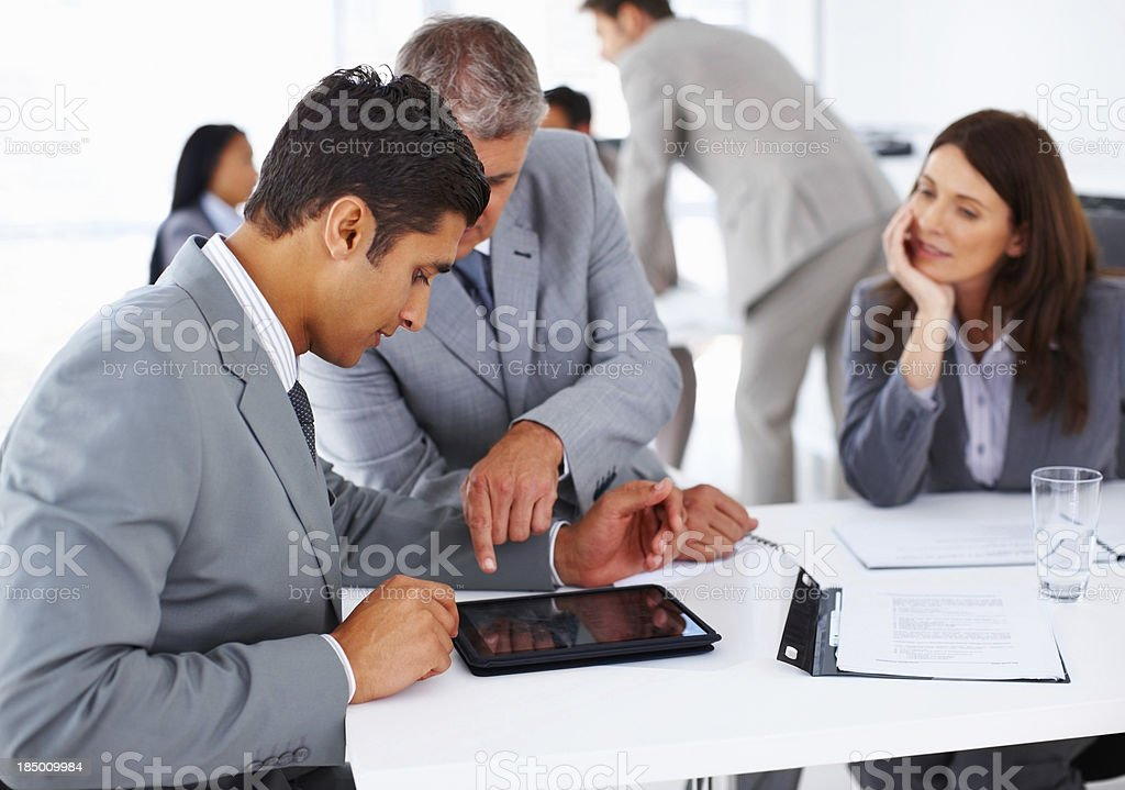 Teamwork aided by cutting edge technology royalty-free stock photo