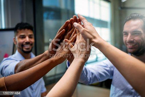 1174511028 istock photo Teamwork and team spirit 1202251454