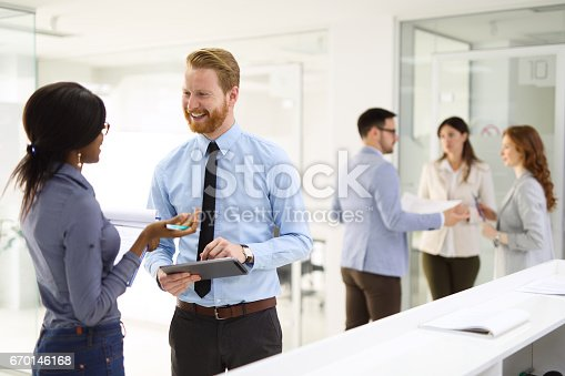 istock Teamwork and technology - Invaluable to modern business 670146168