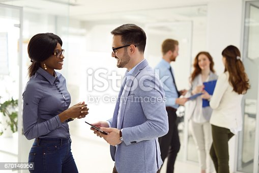 istock Teamwork and technology - Invaluable to modern business 670146950