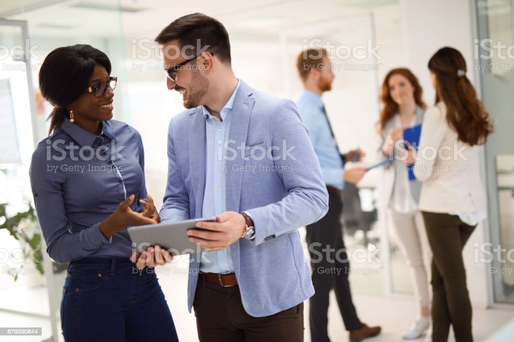 Teamwork and technology - Invaluable to modern business royalty-free stock photo