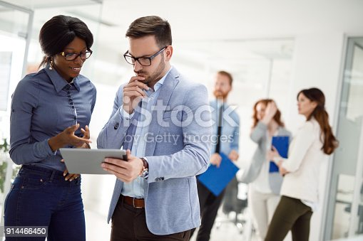 istock Teamwork and technology - Invaluable to modern business 914466450