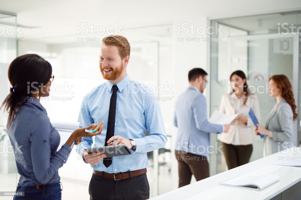 Teamwork and technology - Invaluable to modern business stock photo