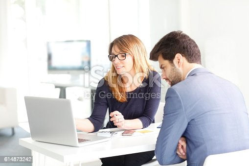 istock Teamwork at office 614873242