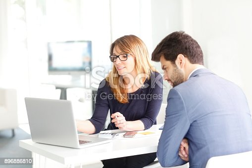 istock Teamwork at office 896886810
