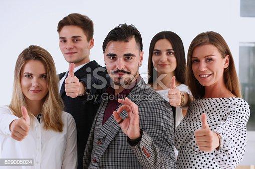 istock Teamwork business concept group people ok finger 829005024