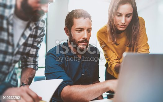 912969272istockphoto Teamwork business concept.Young Coworkers sitting at meeting room and using laptop.Horizontal.Blurred background. 912952292
