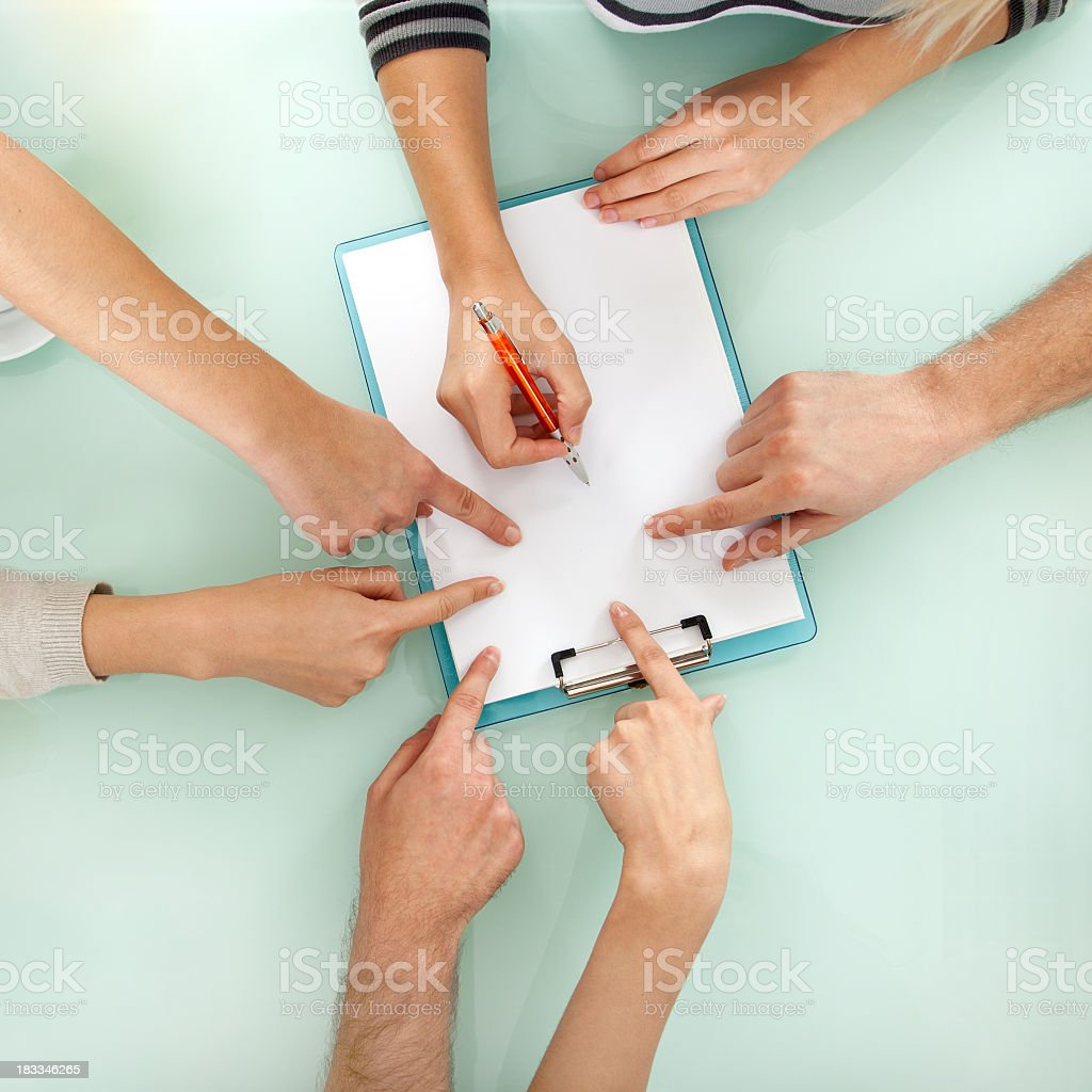 Teamwork - Business hands working with document on meeting stock photo