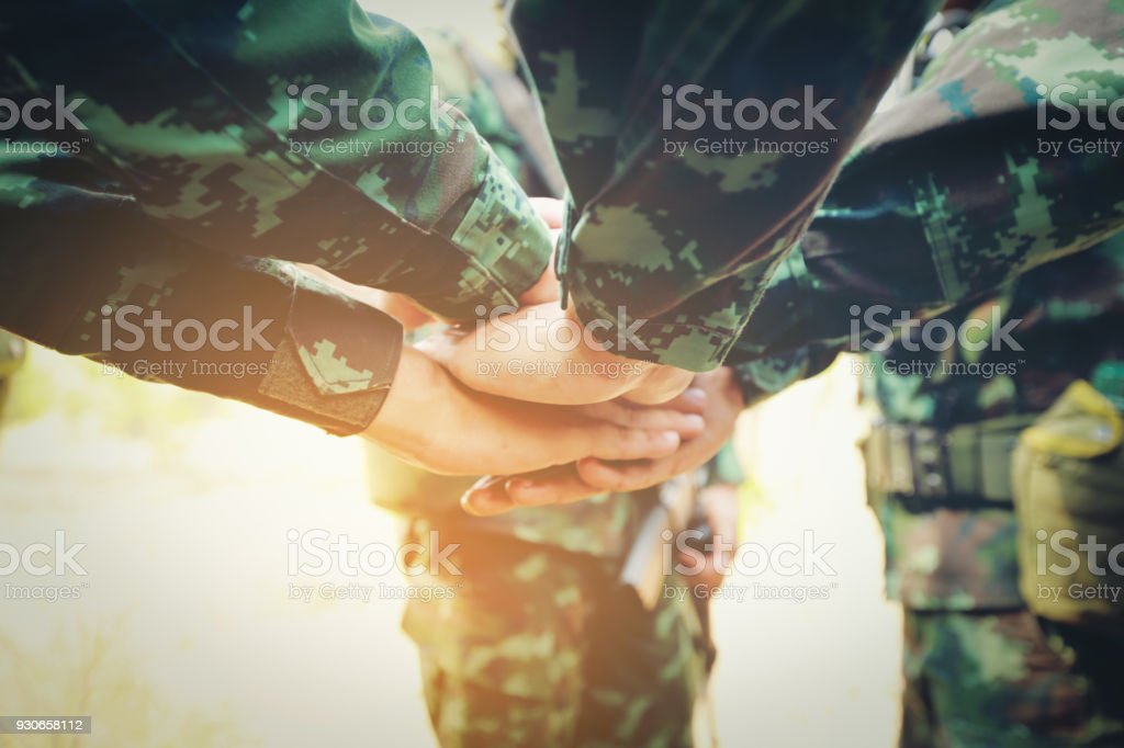 Teamwork Concept : Group of Soldier Hands Together Cross Processing ready to fight. stock photo